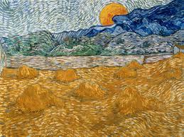 covoni di grano e luna che sorge